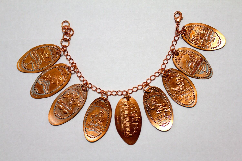 deluxe disneyland pressed charm bracelet