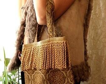 Golden fringe purse