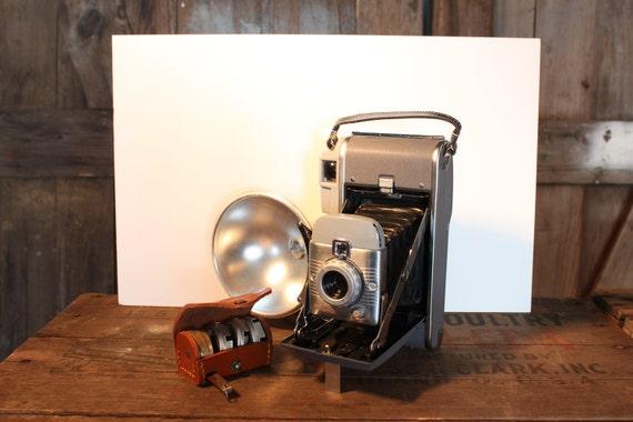 The Polaroid Land Camera Model 80 w/ Accessories