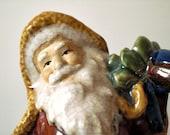 Vintage Santa figure. Rustic Christmas decor. Beautiful crackled glaze.