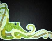 Die cut green octopus.