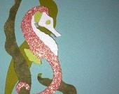 Pink and white seahorse die cut.