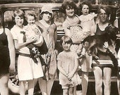 Snapshot picture with a group of children - a few in swimsuits posing in front of Ford sedan - 1920s photograph