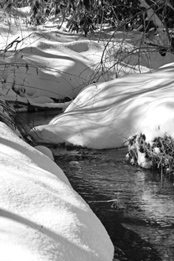 Small Stream with Snow Covered Banks