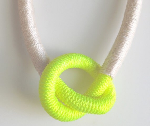 Neon yellow knot necklace wrapped in light pink thread