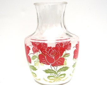 Vintage Beverage Container with Rose Design