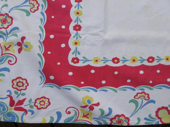 Vintage tablecloth in a fun red floral pattern