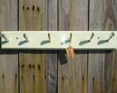 Hand made coat rack from reclaimed wood and vintage knife ends. Painted shabby chic, retro, French style.