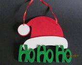 Santa Hat with Ho Ho Ho Hanging Sign
