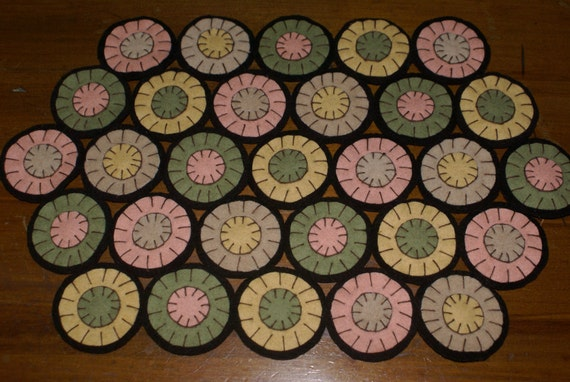 primitive folk art wool penny circle penny  rug candle mat