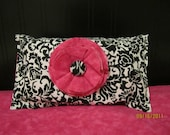 black and pink diapers and wipes case
