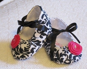 black, white and pink baby shoes