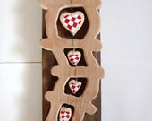 Nursery wooden baby's room decor with red hearts