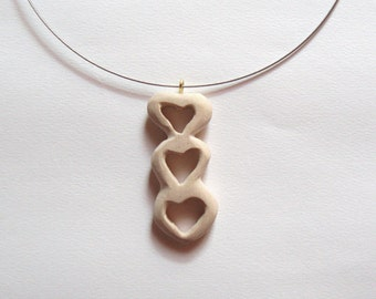 Wooden natural necklace Trilogy of hearts