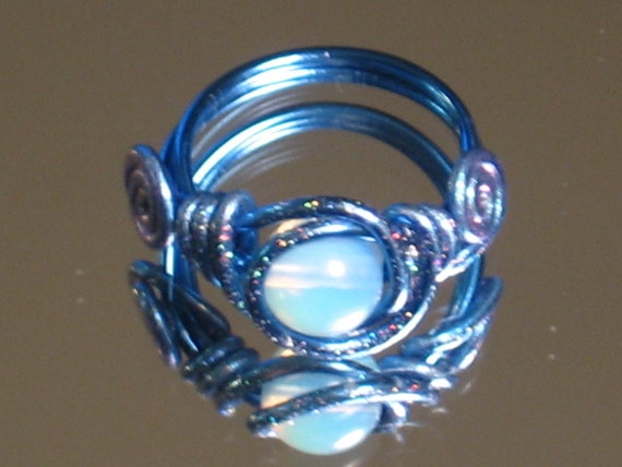 50% OFF SALE. Opal bead blue wire wrapped ring. Painted with glitter paint. Metallic blue aluminum wire. Ring sz 7