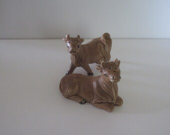 Brown ceramic COW SALT and PEPPER shakers