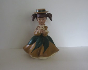 VINTAGE CERAMIC GIRL.  with Lily  1969