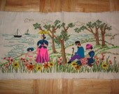 Vintage Sampler handmade wall hanging of a picnic in the park