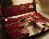 Handy wine red vintage travel purse with brush, cream boxes, mirror, all clean and in perfect shape