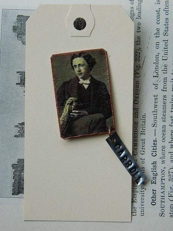 Lewis Carroll lapel pin with handstamped tag author Victorian era 1800s writer jewelry