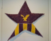 "Handpainted burlap star in your school colors and mascot symbol or school initials.  29""w x 30""h"