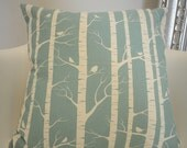 handmade cushion cover screen printed in duck egg blue birch design on organic cream cotton fabric