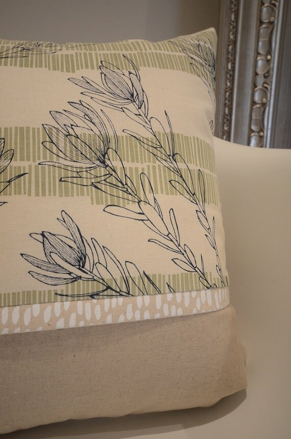 handmade cushion cover screen printed in ink blue and olive leuca design on organic raw cotton fabric