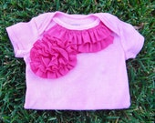 Pink onesie with dark pink ruffles and flowers for baby girl in size 6 months