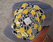 Sale....Cadet Military Distressed Hat Grey with a Black and Yellow Variegated Petal Flower and Rhinestone Accent.