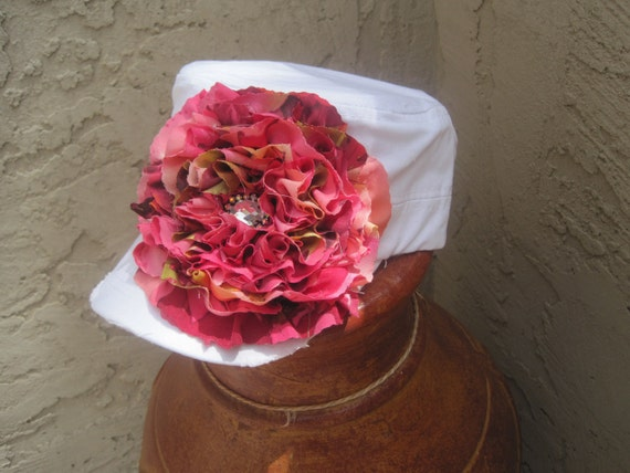 White Cadet Military Distressed Hat with A Beautiful Coral Pink Chiffon Flower and Rhinestone Accent.
