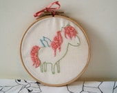Pretty Pegasus with pink hair and blue wings embroidery piece for wall decoration