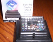 9 individually boxed LED LIGHT UP display stands