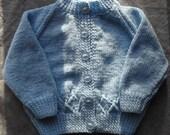 Girls sweater in blue, hand knit