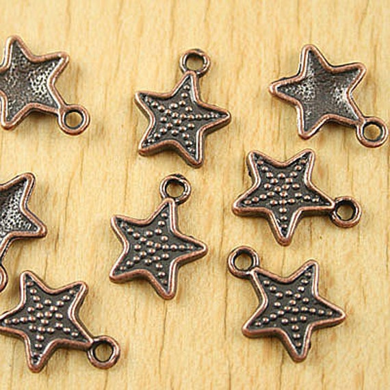 4 Antiqued Red Copper Tone Star Charms 4210