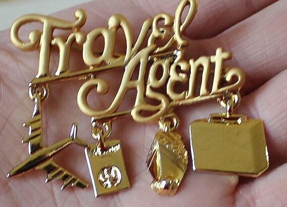 "vintage marked danecraft gold plated ""TRAVEL AGENT"" brooch R12"