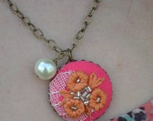 03 Hand embroidered pendant: orange flowers with lace and pink background