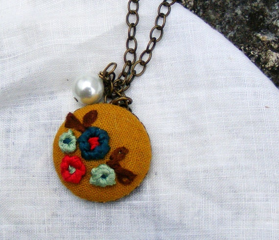 03 The June:  embroidered flower pendant with mustard background and pearl