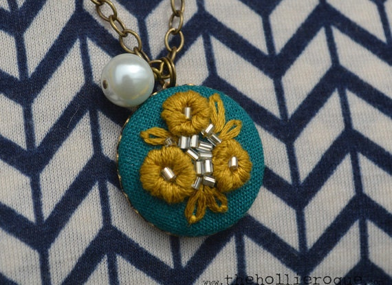 03 Hand embroidered pendant: mustard-colored flowers on aqua background