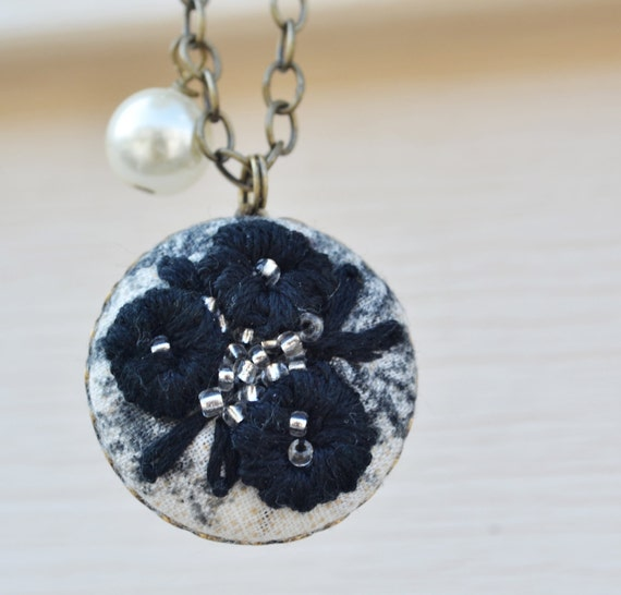 03 Hand embroidered pendant: black flowers on black and cream background