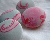 pink octopus buttons, 4 1 1/8 in covered buttons with pink octopus on pale aqua ground
