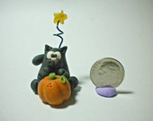 Halloween black cat with pumpkin and shooting star polymer clay figurine