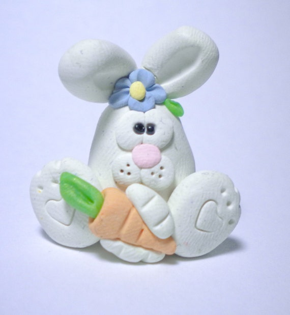 Frank the Easter Bunny is addicted to carrots...he needs an intervention.  You can help. Polymer clay bunny rabbit.