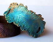 Peacock Feather trimmed in bronze, leather wristband, polymer clay focal bead, peacock feather,