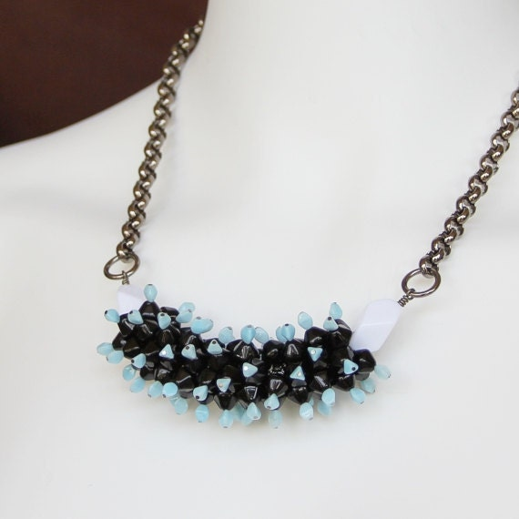 Beaded Necklace: Unique statement necklace in pale blue and jet black.