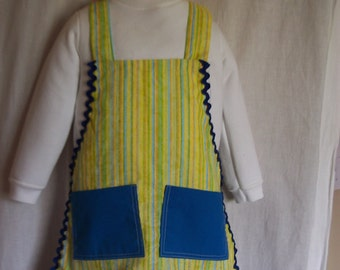 Childs full apron Bright yellow blue green stripe with bright blue pockets Bright blue rick rack trim Size 2 - 5