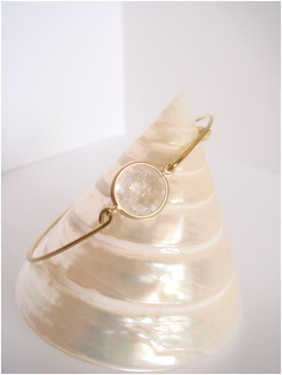 Crystal clear faceted glass and gold bangle