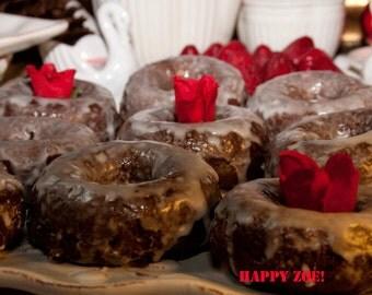 Vegan Gluten free plain chocolate  Donuts with plain glaze,  love, animal free cruelty,no eggs,no dairy.