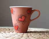 Tall tea cup with love motif - clay pottery
