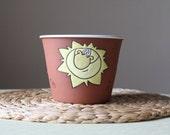 Flower pot - sun motif, glazed inside