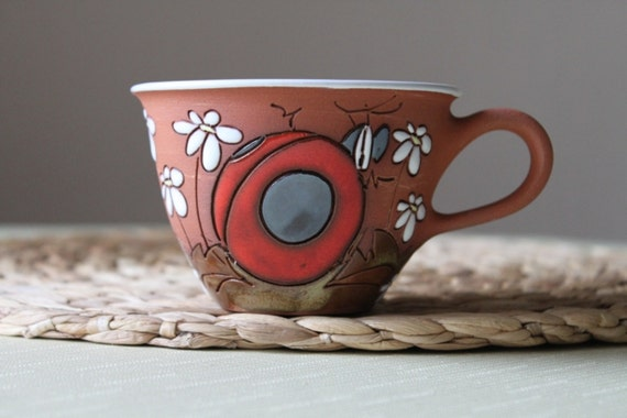 Cappuccino cup with ladybird, daisies / flowers motif
